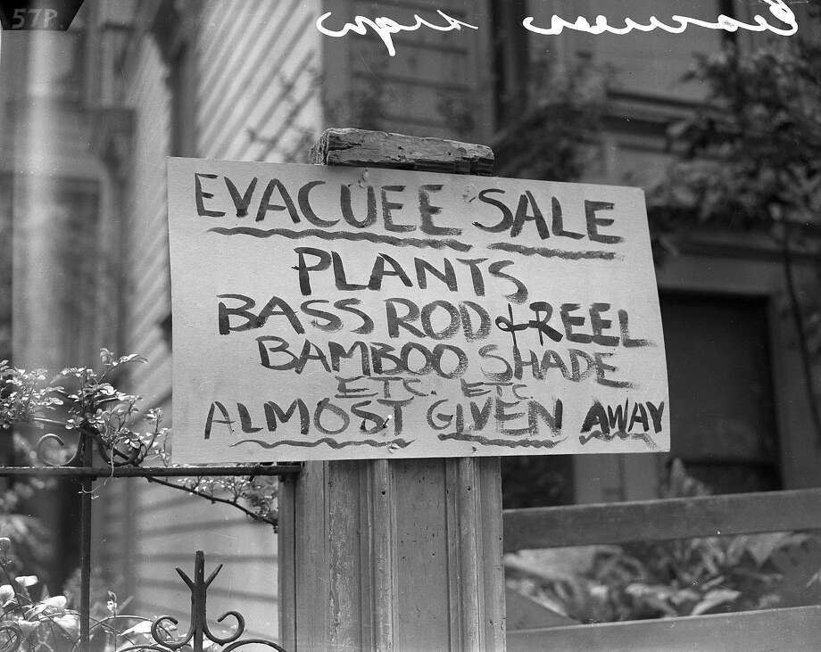 A sign outside a business owned by a San Francisco employer is seen on April 6, 1942, during the month of a final order for citizens of Japanese descent to leave the city for internment camps. Photo: Chronicle File Photo, The Chronicle
