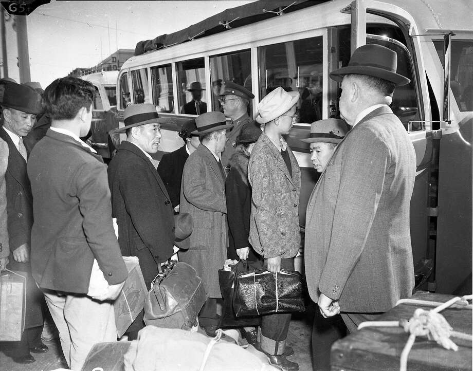 April 6, 1942: San Franciscans of Japanese descent board a bus out of San Francisco, to an internment camp at Tanforan Park. Photo: Chronicle File Photo, The Chronicle