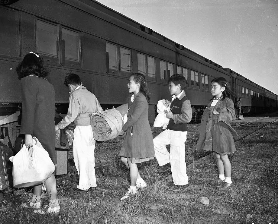 In September 1942, California children from Japanese families, who had already been forcibly displaced from their homes, board a train from the Tanforan internment camp to another camp in Utah. Photo: Chronicle File Photo, The Chronicle