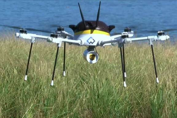 This photo shows  a test drone making a UPS delivery in Mass-achusetts in September. The company conducted another test on Monday.