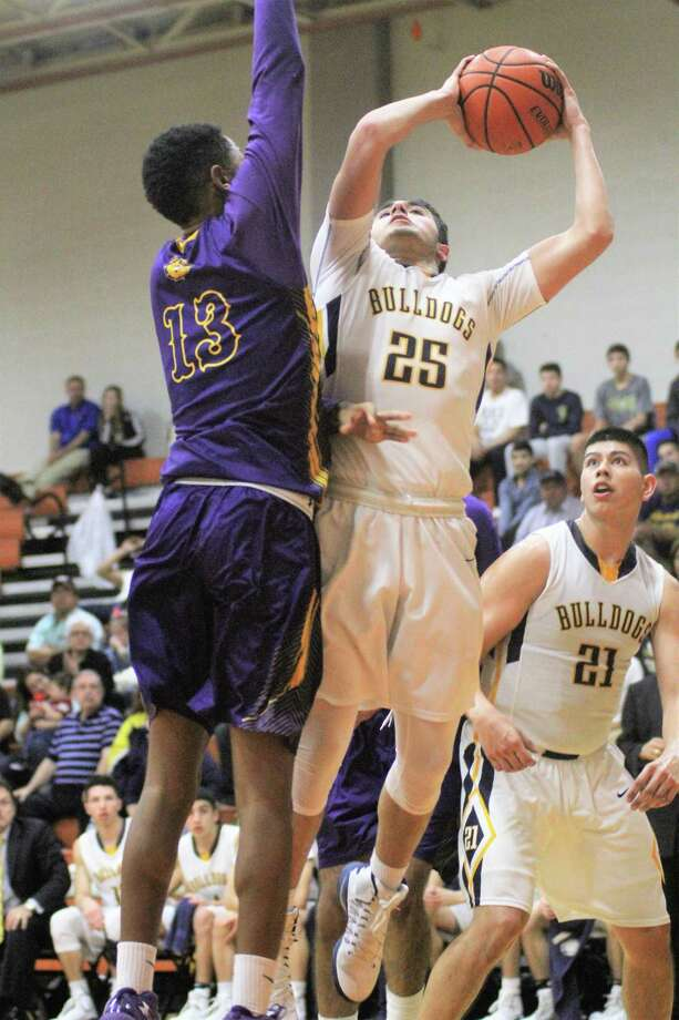 Ramiro Ortiz and Alexander host McAllen at 7 p.m. Tuesday in a rematch of last year's first round. Ortiz had a team-high 16 points in last year's 67-57 loss. Photo: Jason Mack /Laredo Morning Times File