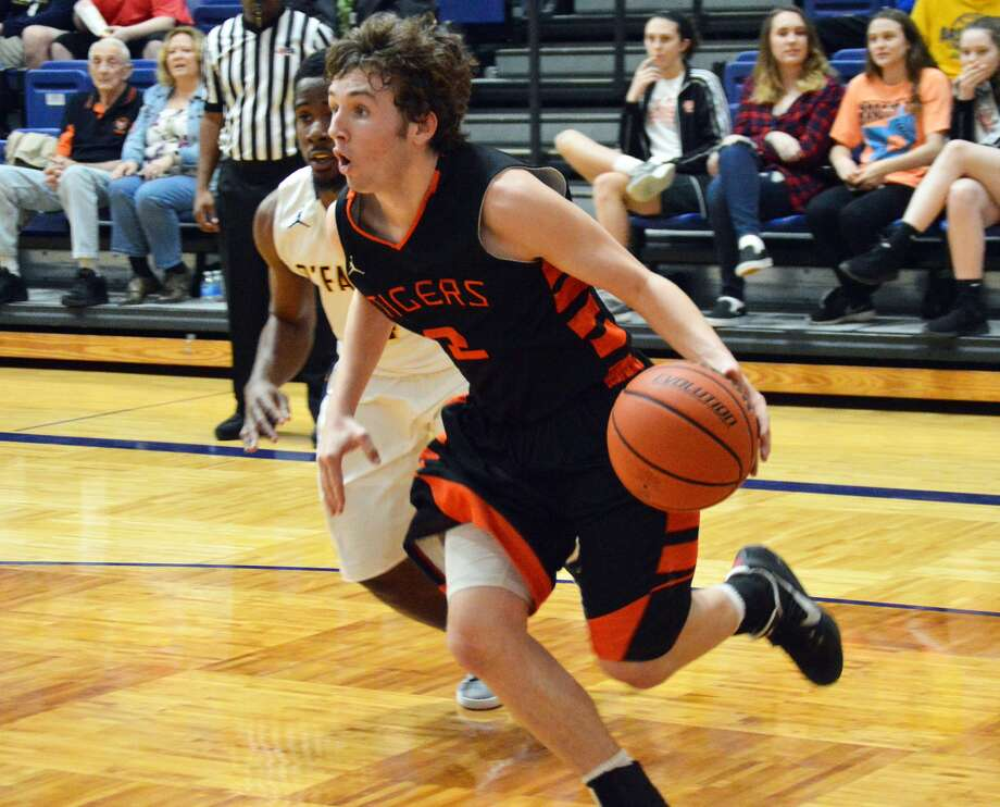 Edwardsville junior guard Jack Marinko, front, drives baseline late in the third quarter of Tuesday's game at O'Fallon.
