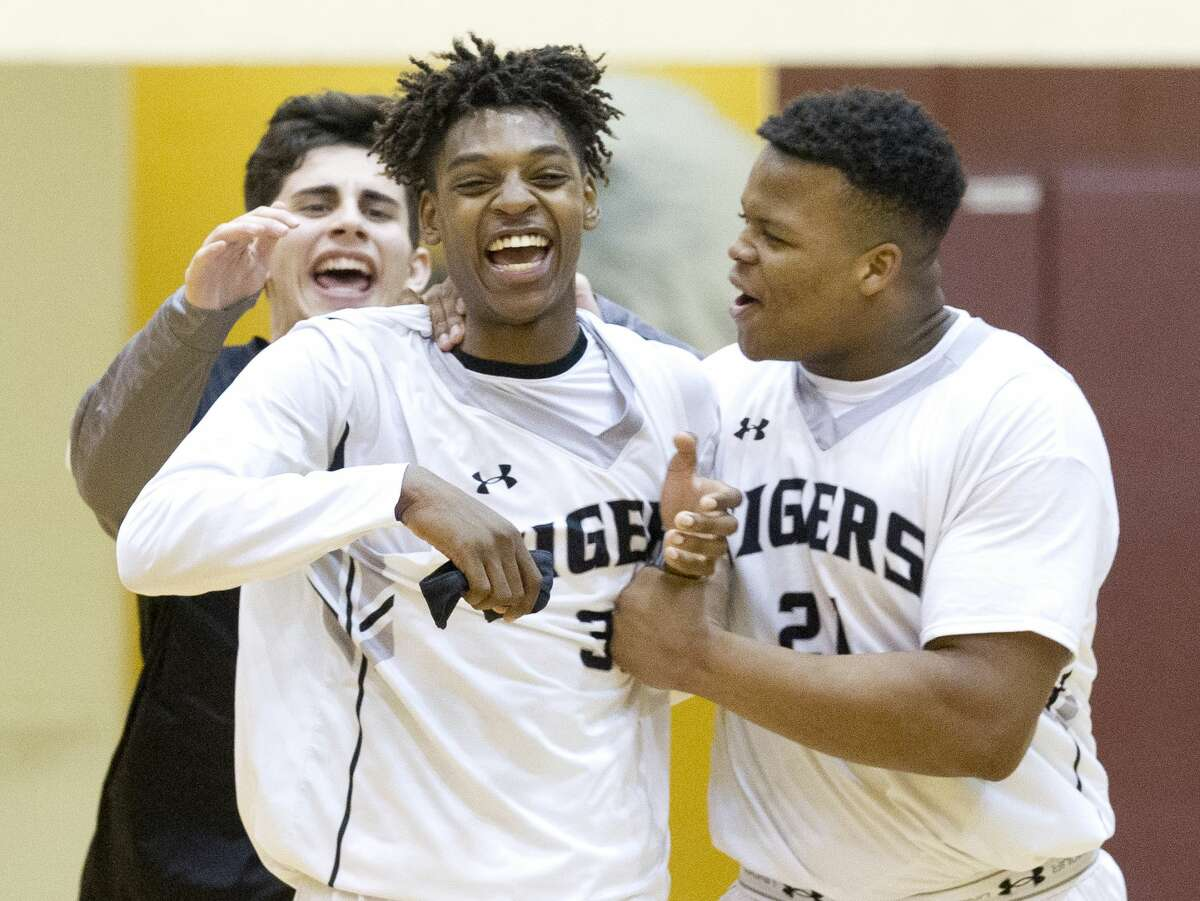 Conroe guard Qiandrae Edmond (30) celebrates with forward Lavery Shepherd (21) after hitting the game-winning three-pointer at the buzzer to give the Tigers a 74-71 win over Rockwall-Heath during a Region II-6A high school basketball bi-district playoff game at Johnson Activities Center Tuesday, Feb. 21, 2017, in Fairfield.