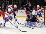Montreal Canadiens left wing Paul Byron (41) tries to score on New York Rangers goalie Henrik Lundqvist (30) as defenseman Marc Staal (18) helps Lundqvist during the first period of an NHL hockey game, Tuesday, Feb. 21, 2017, in New York. (AP Photo/Julie Jacobson) ORG XMIT: MSG103