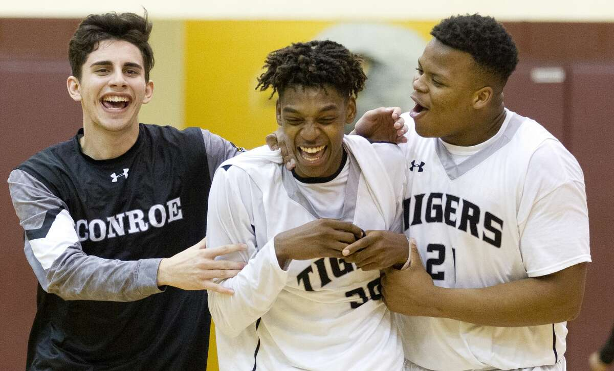 Feb. 21: Conroe 74, Rockwall Heath 71 Conroe guard Qiandrae Edmond, center, celebrates with teammates after hitting the game-winning three-pointer at the buzzer to give the Tigers a 74-71 win over Rockwall-Heath during a Region II-6A high school basketball bi-district playoff game at Johnson Activities Center Tuesday, Feb. 21, 2017, in Fairfield.
