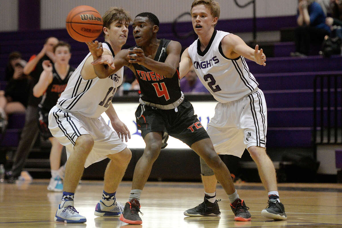 Midland Classical's Cole Miller (12) and Conrey Echols (2) go after Covenant School's Brian Davis (4) on Tuesday, Feb. 21, 2017, at Midland Classical Academy. James Durbin/Reporter-Telegram