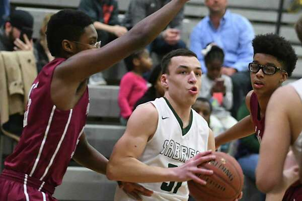 Schalmont's Troy Moran drives to the basket during a basketball game against Watervliet on Tuesday, Feb. 21, 2017 in Rotterdam, N.Y. (Lori Van Buren / Times Union)
