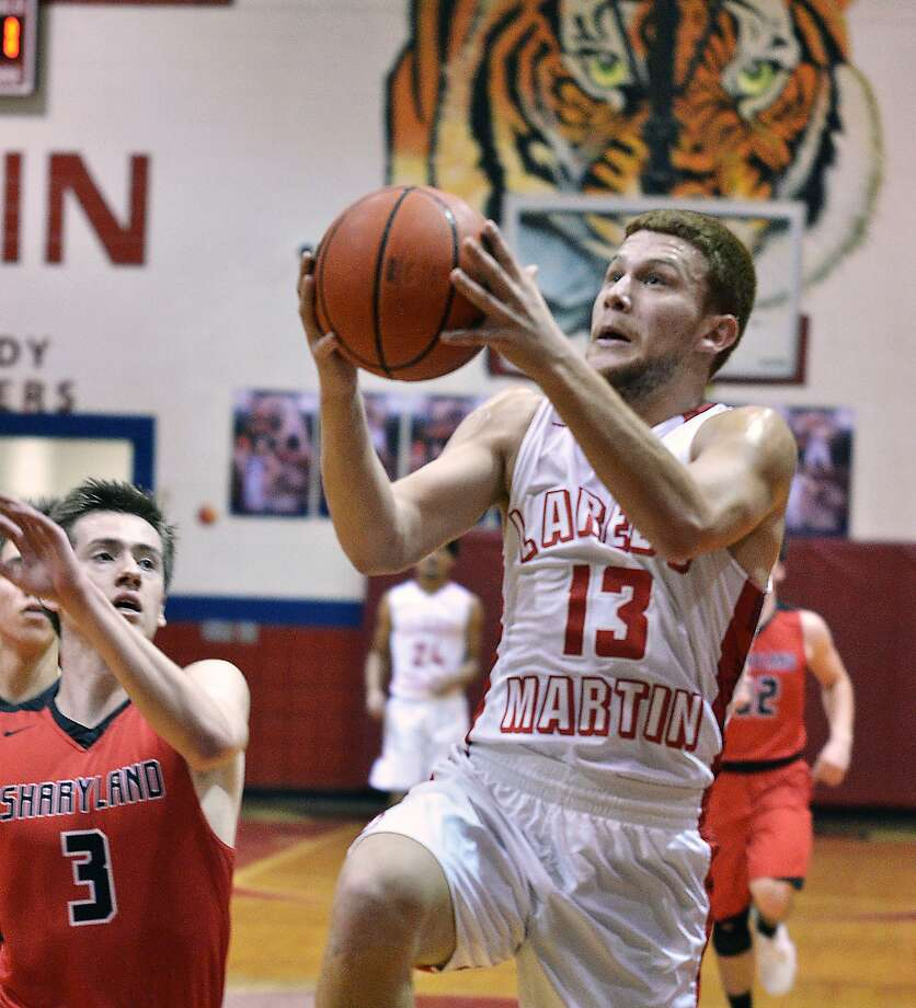 Martin's Luis Omar Ortegon and the Tigers downed Brownsville Pace 67-50 on Tuesday. Photo: Cuate Santos /Laredo Morning Times File / Laredo Morning Times