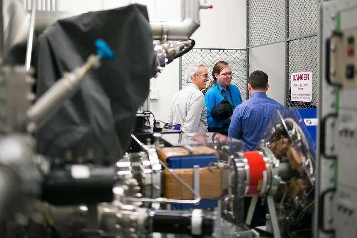 Lockheed Martin employees explore the new Space Environmental Test Facility during a tour of the Space Plasma and Radiation Center (SPARC) at Lockheed Martin Space Systems in Palo Alto, Calif. Tuesday, February 21, 2017.