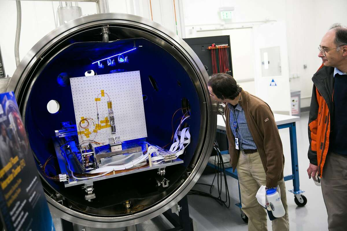 Lockheed Martin employees explore the Experimental Plasma Interaction Chamber (EPIC) during a tour of the Space Plasma and Radiation Center (SPARC) at Lockheed Martin Space Systems in Palo Alto, Calif. Tuesday, February 21, 2017.