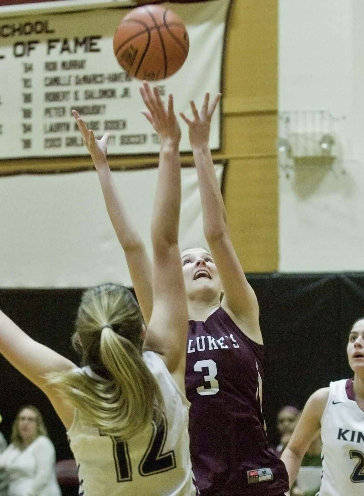 St. Luke's School's Bridget Dalton tries for the rebound in a game against King School, played at St. Luke's. Tuesday, Feb. 21, 2017