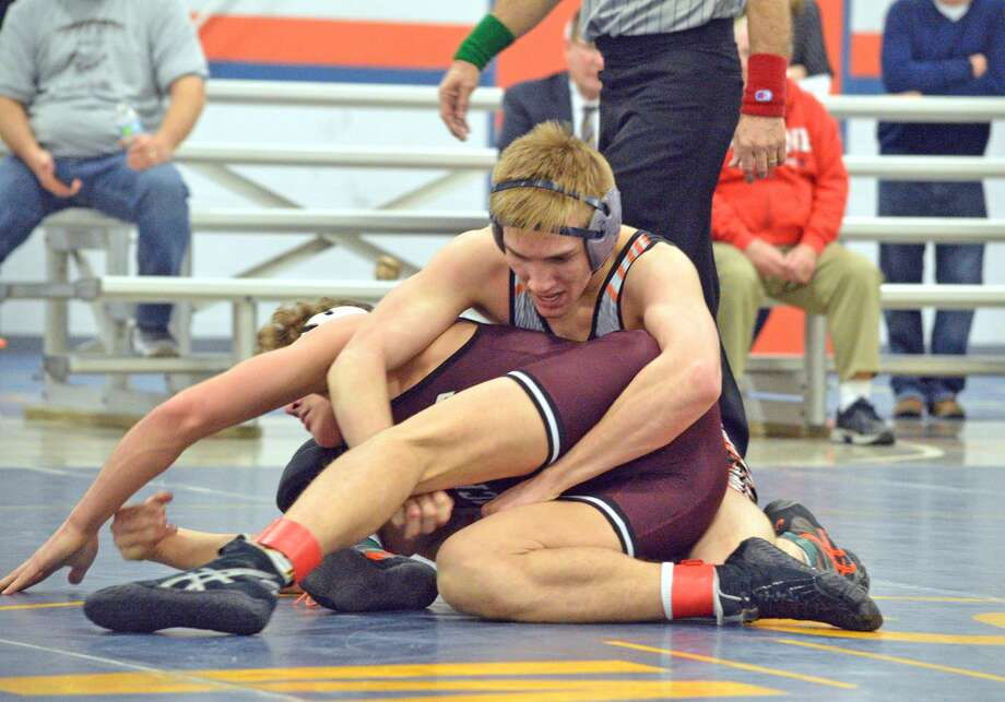 Edwardsville senior Baylor Montgomery tries to get a grip on Lockport Township's Baylor Fernandes during a 152-pound match on Tuesday at the Class 3A Mahomet-Seymour Dual Team Sectional.
