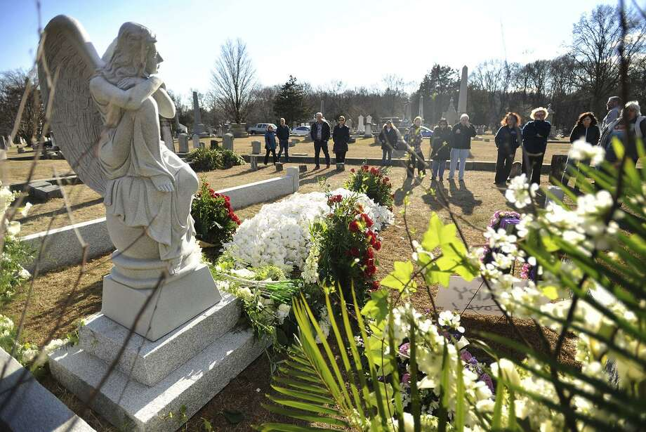 In a Sunday, Jan. 29, 2017 photo, visitors view the gravesite of actress Mary Tyler Moore following her private funeral at Oak Lawn Cemetery in Fairfield, Conn. (Brian A. Pounds/Hearst Connecticut Media via AP) Photo: Brian A. Pounds / Associated Press / Connecticut Post