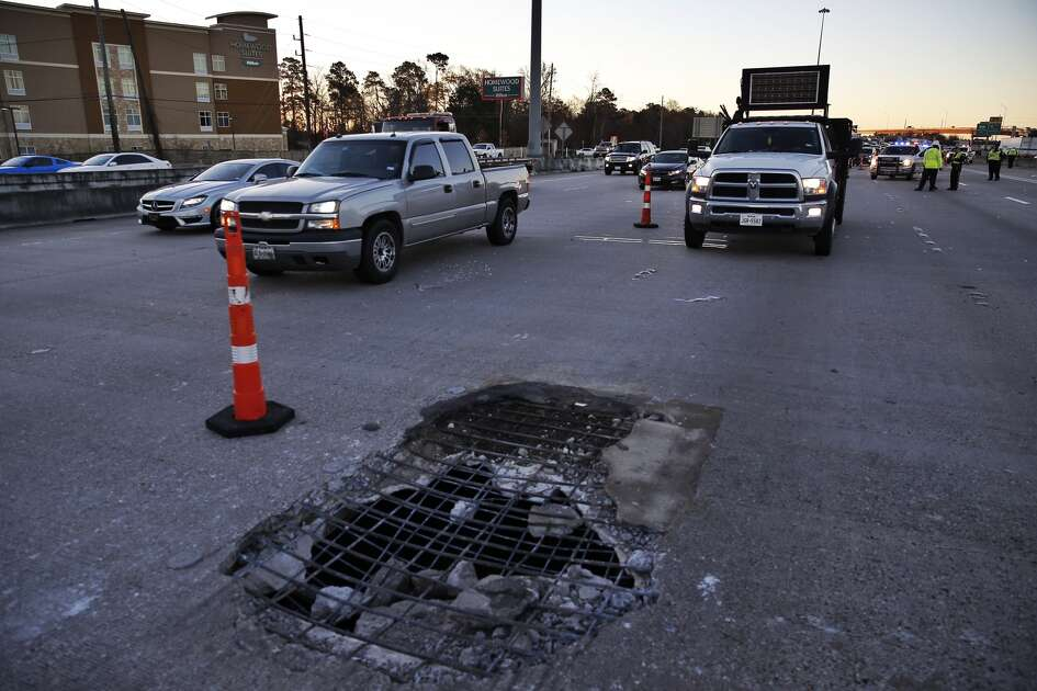 Crews redirect traffic on I-45 around a massive pothole in the middle of the interstate that has closed all but two lanes north of the Hardy Toll Road Wednesday, Feb. 22, 2017 in Spring, Texas.