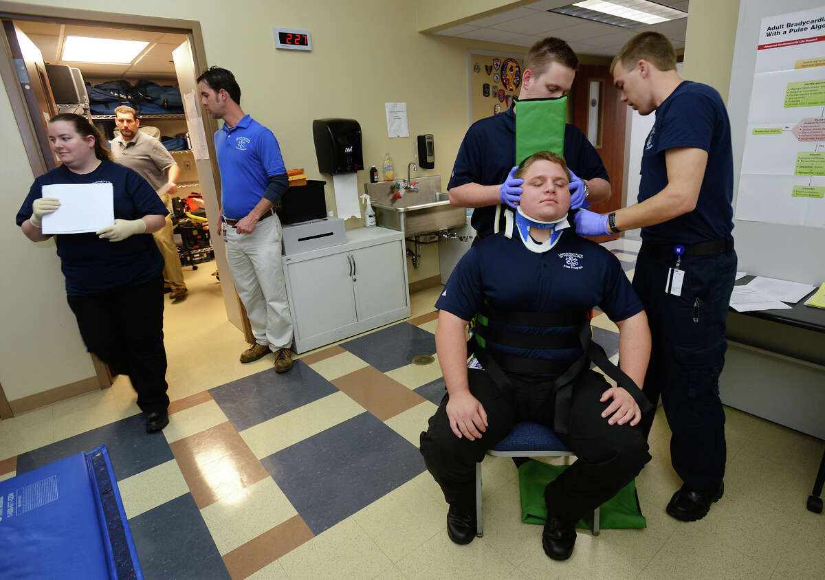 A paramedic class works on car accident injuries at Lamar Institute of Technology Tuesday. Due to low pay and long training hours, the number of local paramedics is declining. Photo taken Tuesday, February 21, 2017 Guiseppe Barranco/The Enterprise