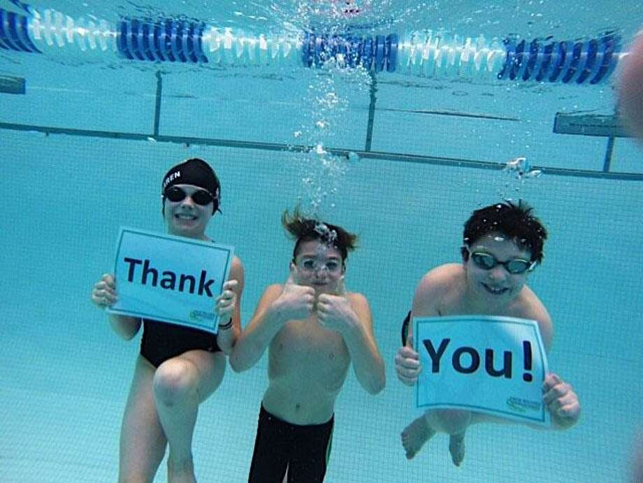 "On behalf of the New Milford Barrachudas swim team, swimmers Meghan MacLaren, Matthew Georgoulis and Spencer Skidell offer an underwater ""thank you"" to the community for their support of the Barracudas' third annual swimathon held recently at Canterbury School. Photo: Courtesy Of New Milford Barracudas / The News-Times Contributed"