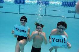 """On behalf of the New Milford Barrachudas swim team, swimmers Meghan MacLaren, Matthew Georgoulis and Spencer Skidell offer an underwater """"thank you"""" to the community for their support of the Barracudas' third annual swimathon held recently at Canterbury School."""
