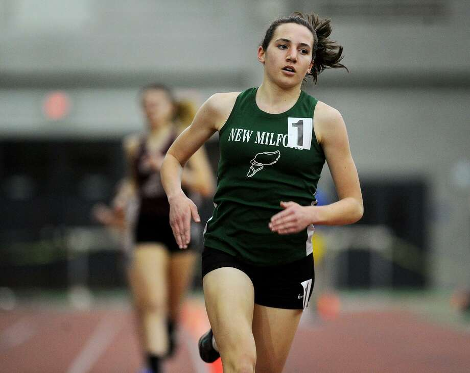 New Milford's Mia Nahom opens up a large lead on the way to an easy win in the 1600 meters at the CIAC State Championship Indoor Track & Field Meet at the Floyd Little Athletic Center in New Haven, Conn. on Monday, February 20, 2016. Photo: Brian A. Pounds / Hearst Connecticut Media / Connecticut Post