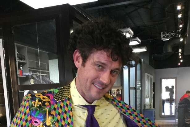Local restauranteur Brooks Brasser, owner of BBs café , wears a Balani Custom suit for Mardi Gras. Balani's presidenet Christian Boehm calls it the Balani X-Files.