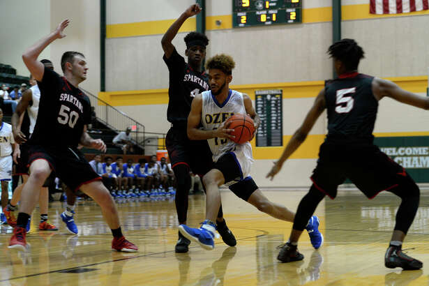 Ozen's Trevonte Reed drives against Porter during the first quarter in a Class 5A bi-district playoff game at East Chambers High School on Tuesday evening.  Photo taken Tuesday 2/21/17 Ryan Pelham/The Enterprise