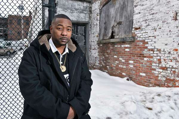 Hip-hop artist/entrepreneur Simon Grimes aka Sime Gezus on Putnam Street Thursday Feb. 16, 2017 in Saratoga Springs, NY.  (John Carl D'Annibale / Times Union)