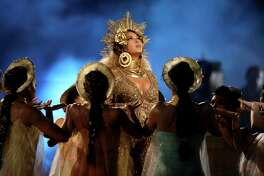 FILE - In this Sunday, Feb. 12, 2017 file photo, Beyonce performs at the 59th annual Grammy Awards, in Los Angeles. Britain's music industry will salute chart-topping talent and departed icons at the Brit Awards on Wednesday, Feb. 22, 2017 where nominees include Drake, Beyonce and David Bowie. (Photo by Matt Sayles/Invision/AP, File)
