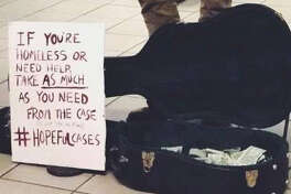 Will Boyajian's guitar case and sign for his #HopefulCases campaign to raise money for the homless in New York City. (Photo courtesy Will Boyajian.) ORG XMIT: sHjNwdbzrmOHOLl6xSS_