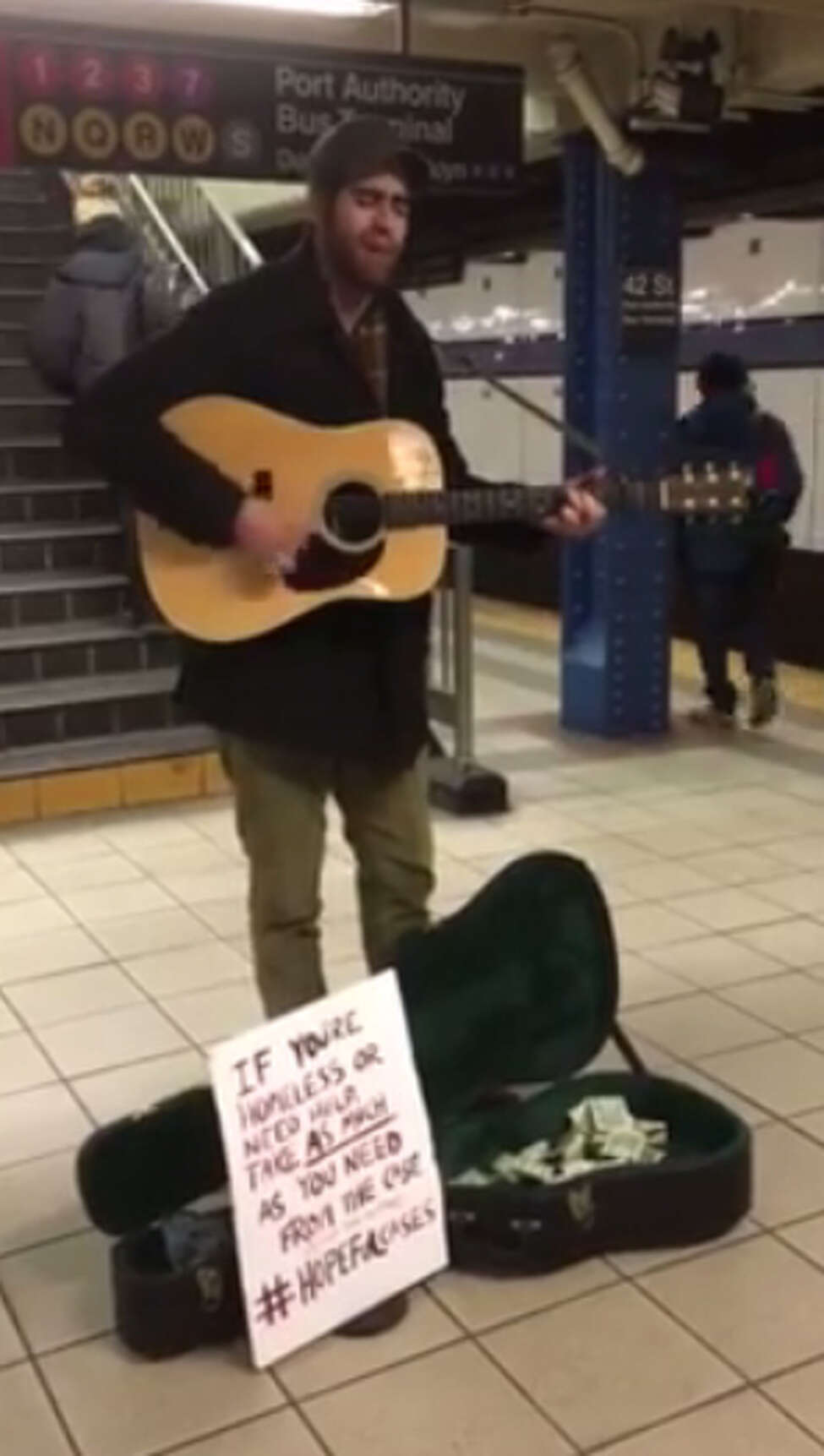 Screen grab from a video of Clifton Park native Will Boyajian performing in the 42nd Street-Times Square subway station in Manhattan as part of his #HopefulCases campaign to raise money for the homless in New York City. (Photo courtesy Will Boyajian.)