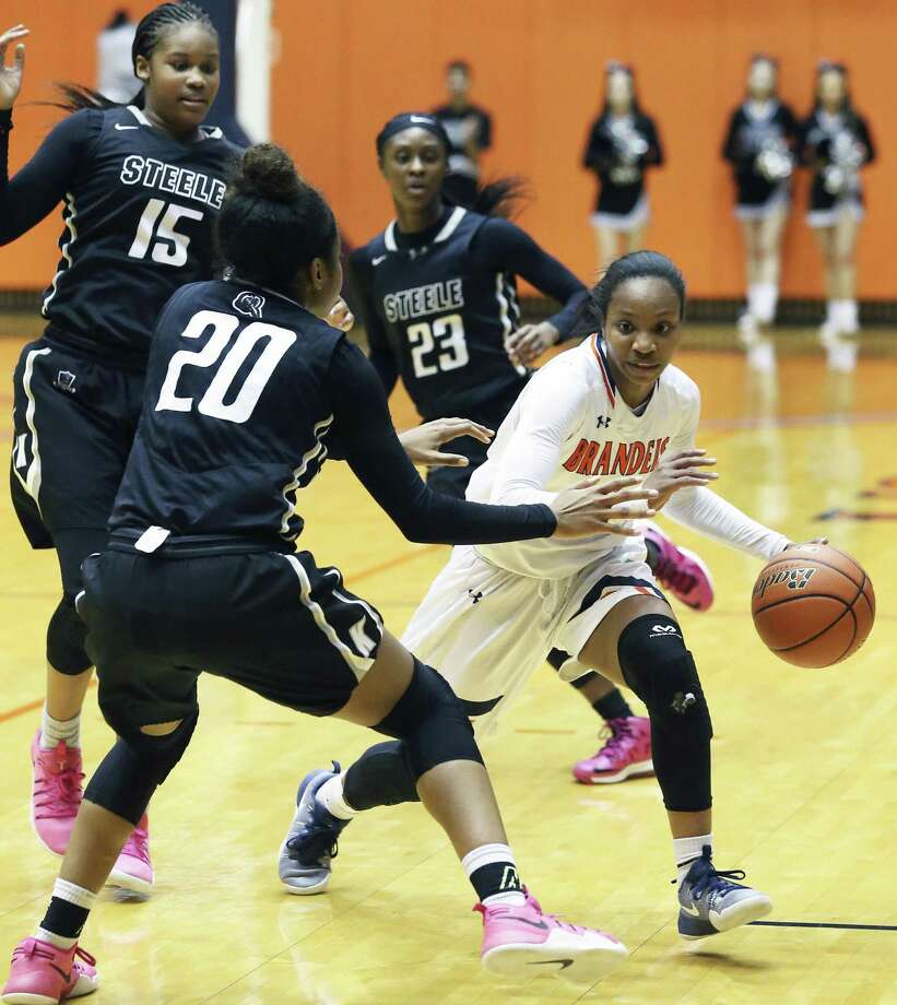 Gabby Connally is confronted by three defenders as she brings the ball upcourt in the second half as Brandeis plays Steele in class 6A third round playoff action at UTSA on February 21, 2017. Photo: Tom Reel, Staff / San Antonio Express-News / 2017 SAN ANTONIO EXPRESS-NEWS