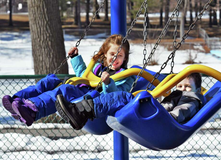 Six-year-old Victoria and her 4-year-old brother, Lucas Beauregard, of Niskayuna swing in the sunshine in Central Park Wednesday Feb. 22, 2017 in Schenectady, NY.  (John Carl D'Annibale / Times Union) Photo: John Carl D'Annibale