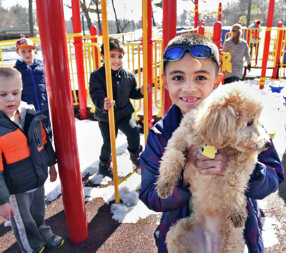 Six-year-old Christopher Gonzalez, right, of Schenectady shows off his new puppy, Coby, in Central Park Wednesday Feb. 22, 2017 in Schenectady, NY.  (John Carl D'Annibale / Times Union) Photo: John Carl D'Annibale