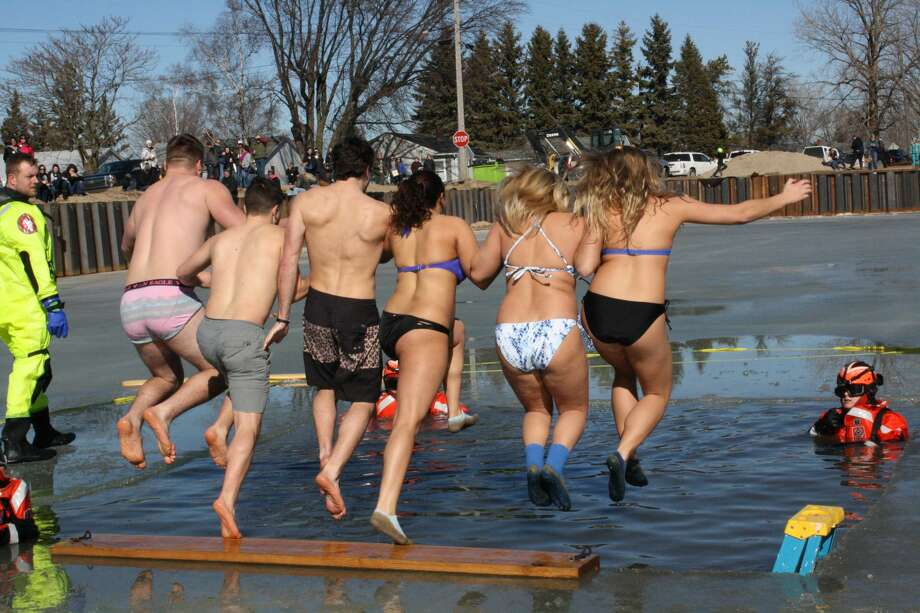 Caseville's annual Shanty Days festival featured plenty of action, including broomball, a polar dip, chick-on-a-stick, chess tournament fun and arts and crafts at a local business. Photo: Rich Harp/For The Tribune