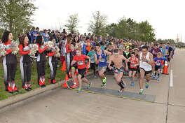 Runners take off at the starting line of the first wave of the fourth annual Superintendent's Fun Run and Festival on Feb. 18.