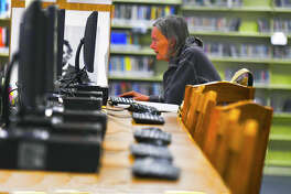 "Susan McLane uses a computer at the Northwest Branch Library in Cypress.         Libraries have been vital in communities for ages. Now, in the era of      digital media and instant information, more people are doing research and      other traditional library tasks digitally. With so many people receiving      information ""on the go,"" local Cypress and Klein libraries are working to      evolve in the digital times."