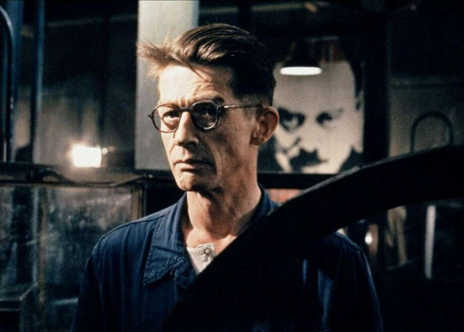"""The late, great John Hurt was perfectly cast as everyman protagonist Winston Smith in Michael Radford's appropriately bleak film adaption of George Orwell's """"1984,"""" released in the year 1984. The late, great Richard Burton delivered one of his finest performances as antagonist O'Brien. Independent cinemas across the country will host screenings of the film in protest of the current presidential administration on April 4. Check local listings. Photo courtesy Twilight Time. Photo: Twilight Time"""
