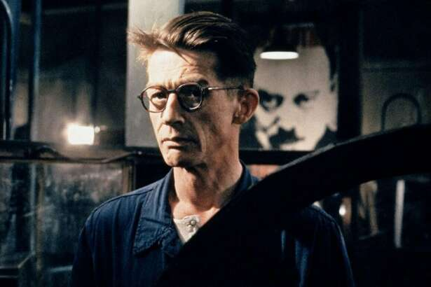 "The late, great John Hurt was perfectly cast as everyman protagonist Winston Smith in Michael Radford's appropriately bleak film adaption of George Orwell's ""1984,"" released in the year 1984. The late, great Richard Burton delivered one of his finest performances as antagonist O'Brien. Independent cinemas across the country will host screenings of the film in protest of the current presidential administration on April 4. Check local listings. Photo courtesy Twilight Time."