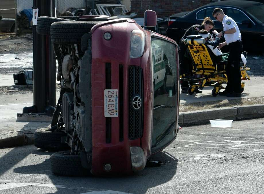 Albany Police Department investigate a rollover with injuries at intersection of Washington Avenue and Ontario Street on Wednesday, Feb. 22, 2017. (Skip Dickstein / Times Union)
