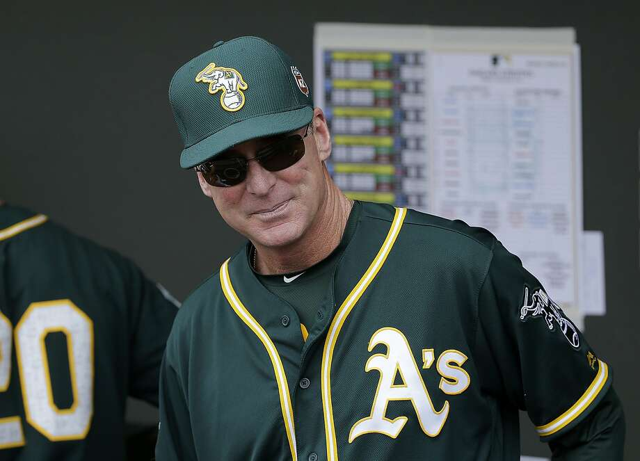 FILE - In this March 28, 2016, file photo, Oakland Athletics manager Bob Melvin watches before a spring training baseball game between the Athletics and the Cleveland Indians in Mesa, Ariz. Melvin has four legitimate closers to choose from and he isn't ready to name any of them his No. 1 option for the ninth inning. (AP Photo/Jeff Chiu, File) Photo: Jeff Chiu, Associated Press