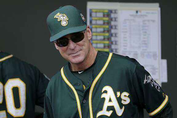 FILE - In this March 28, 2016, file photo, Oakland Athletics manager Bob Melvin watches before a spring training baseball game between the Athletics and the Cleveland Indians in Mesa, Ariz. Melvin has four legitimate closers to choose from and he isn't ready to name any of them his No. 1 option for the ninth inning. (AP Photo/Jeff Chiu, File)