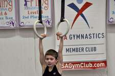 Darien YMCA boys gymnastics team member Ryland Herzog scored 10.7 to take second place on rings at the GTC meet in Simsbury.