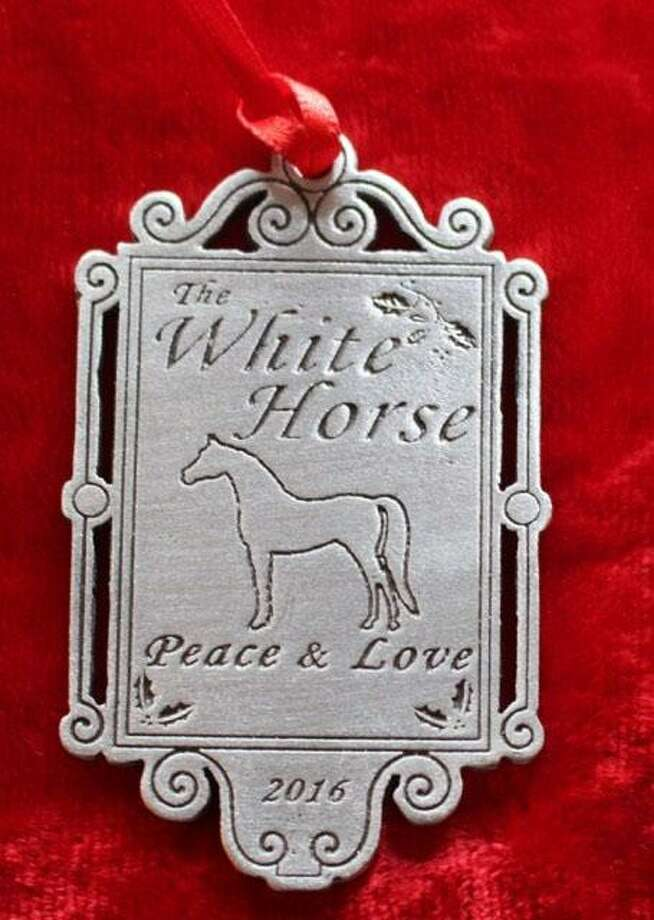 The White Horse Country Pub & Restaurant in New Preston recently sold a special ornament and donated the proceeds to the Connecticut Food Bank. Photo: Courtesy Of White Horse Country Pub & Restaurant / The News-Times Contributed
