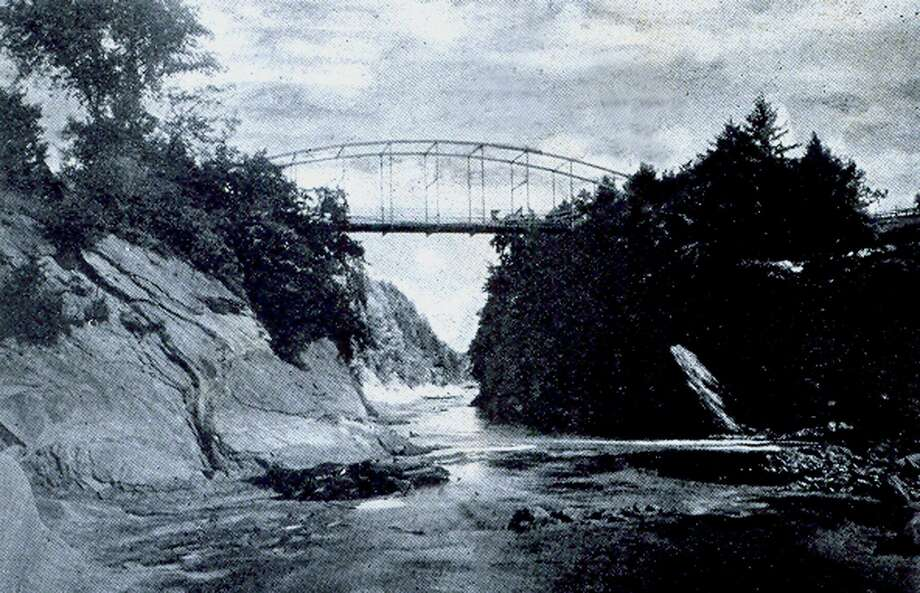 "The Falls Bridge, later to be named Lovers Leap Bridge, over the Housatonic River in New Milford, is a popular landmark in the community. The bridge is shown above in this photo, credited to Hine Studio, the Post Office Building, which was mailed Dec. 10, 1905 to Jeannie P. Goldsmith. If you have a ""Way Back When"" photograph you'd like to share, contact Deborah Rose at 860-355-7324 or drose@newmilford.com. Photo: Contributed Photo / Contributed Photo / The News-Times Contributed"