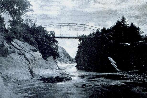 """The Falls Bridge, later to be named Lovers Leap Bridge, over the Housatonic River in New Milford, is a popular landmark in the community. The bridge is shown above in this photo, credited to Hine Studio, the Post Office Building, which was mailed Dec. 10, 1905 to Jeannie P. Goldsmith. If you have a """"Way Back When"""" photograph you'd like to share, contact Deborah Rose at 860-355-7324 or drose@newmilford.com."""