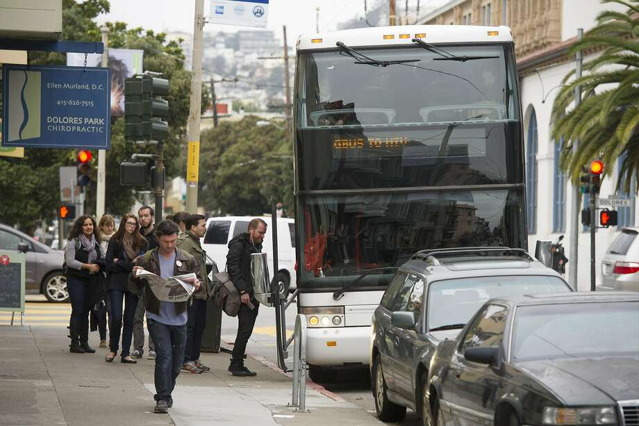 Google Inc. employees board a bus that will take them to the company's campus, in Mountain View, from San Francisco, California, U.S., on Friday, Feb. 14, 2014. Shuttle buses carrying Apple and Google employees were apparently vandalized Tuesday, Jan. 16, 2018, while traveling to and from the South Bay, officials said. No injuries were reported. Photo: David Paul Morris, Bloomberg