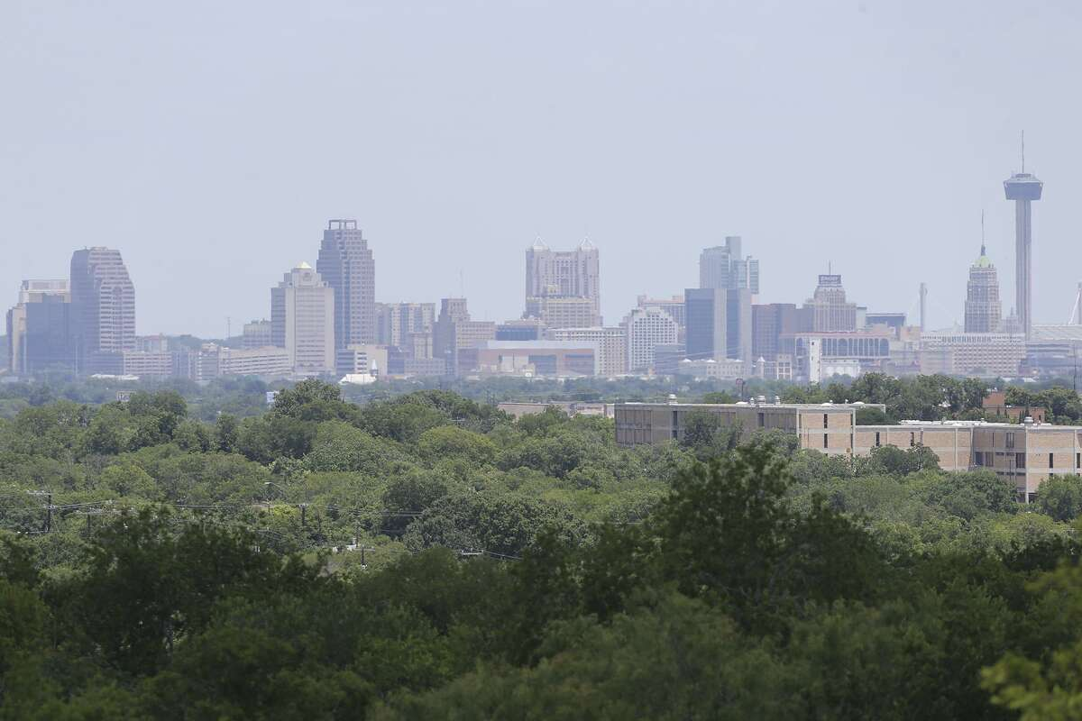 Haze lingers over the downtown skyline midday on July 11, 2013.