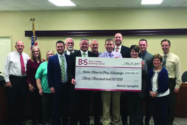 The Bank of Springfield poses with the Edwardsville City Council after donating $30,000 to the Better Place to Play Campaign to contribute to the development of the Plummer Family Sports Park.