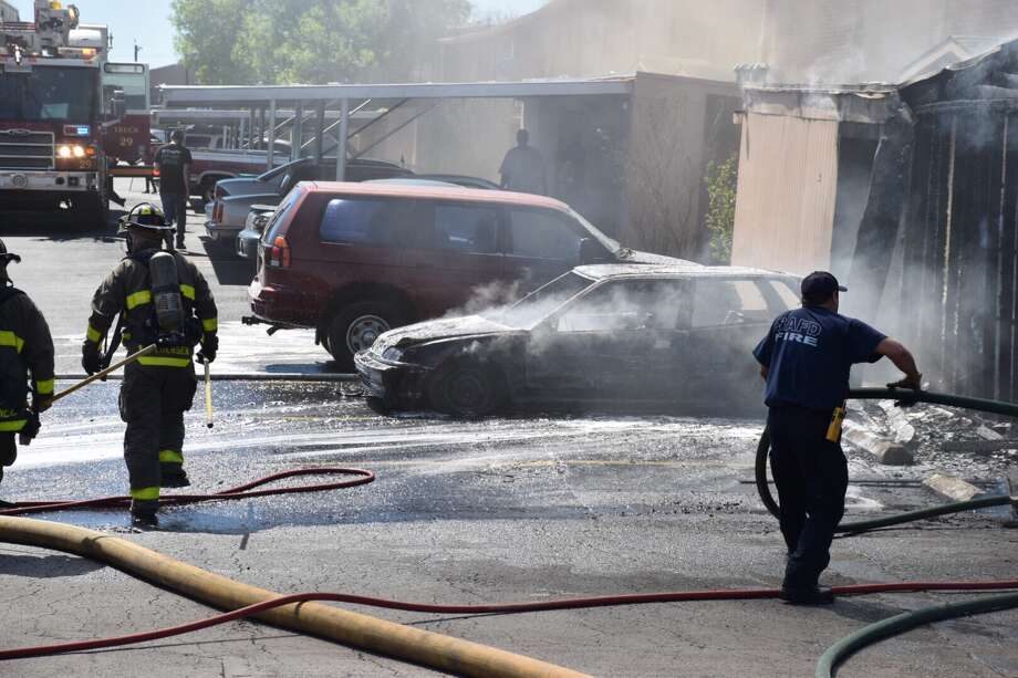 Firefighters on Wednesday, Feb. 22, 2017, respond to an apartment fire that began as a vehicle fire in the 4500 block of Pecan Valley Drive. Photo: Caleb Downs / San Antonio Express-News