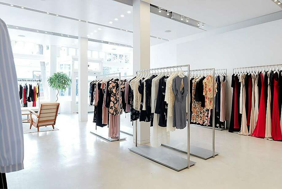 Reformation's minimalist store design features five touch-screen monitors mounted on  white walls, polished cement floors, modern white furniture and a �rammed earth�  feature wall sustainably made from compressed dirt, a design by  Watershed Materials in Napa, that  separates the front showroom from the back dressing  area.�Customers browse and select items to be sent to their dressing room from any  of the touch-screen monitors, a �concierge� calls the customer�s name once the  room is ready and the selections magically appear in an armoire that is  pre-loaded from the back end. Photo: Matthew Millman, � Matthew Millman