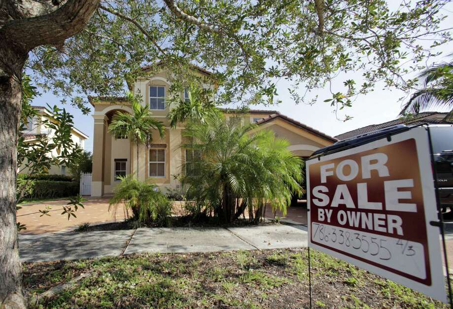A house for sale, in Hialeah, Fla. Americans shrugged off rising mortgage rates and bought existing homes in January at the fastest pace since 2007. Photo: Alan Diaz / Associated Press / Copyright 2016 The Associated Press. All rights reserved.
