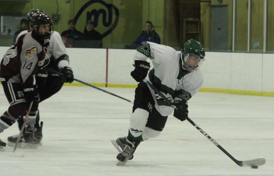 The New Milford High School boys' ice hockey team recently faced off against Milford. The final score was 9-1, with New Milford taking home the win. Above, sophomore Zach Hook makes play on the ice. Photo: Courtesy Of Katie Alzapiedi / The News-Times Contributed